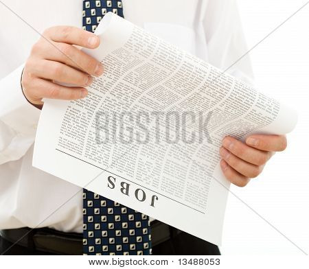 Man In Shirt And Tie Looking For Job - Closeup