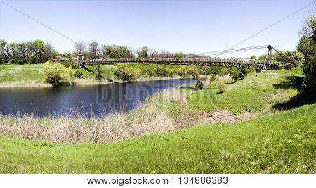 Suspension bridge in the public Botanical Garden of the city of Krivoy Rog in Ukraine