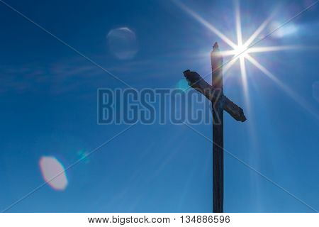 Sunflare With A Cross With A Blue Sky