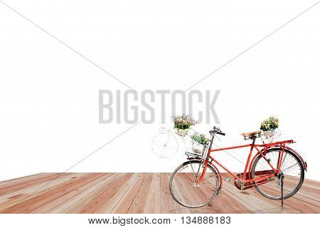 Old red bicycle with flower in basket on wood white background