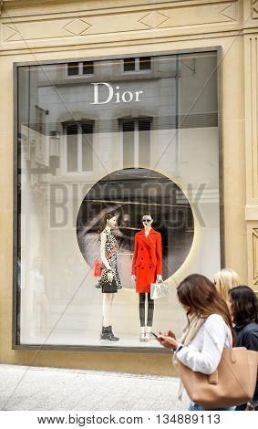 LUXEMBOURG, LUXEMBOURG - JUN 05 2016: Christian Dior fashion store in Luxembourg with pedestrians admiring the facade. Dior is a European luxury goods company controlled and chaired by French businessman Bernard Arnault who also heads LVMH - the world's l
