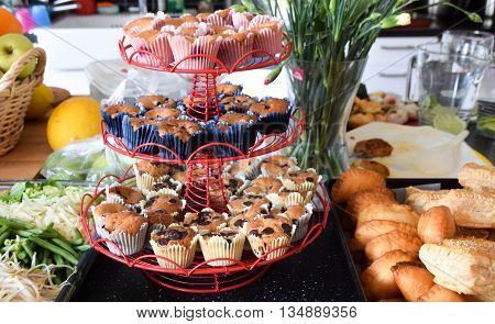 Sweety cupcakes cakes on a plate ready to be served in kitchen environment for party