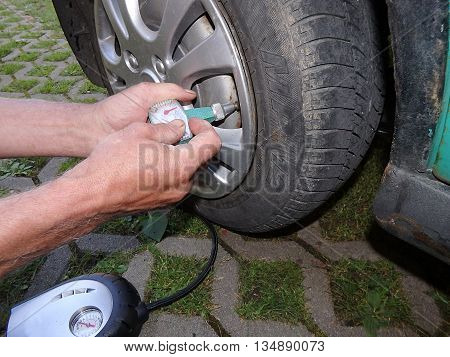 blowing on a car wheel, Inflating a tire