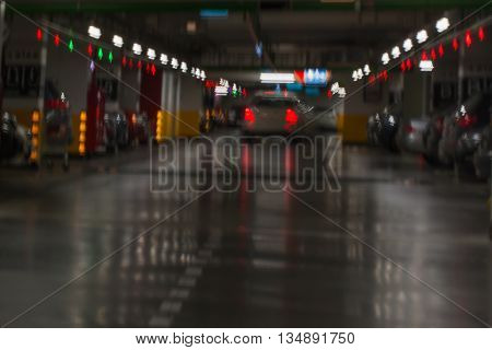 Underground parking garage with cars, blur dark background