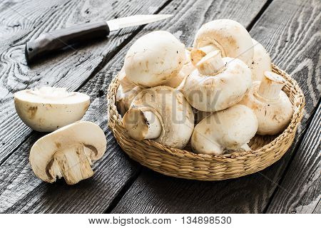 Fresh mushrooms in a basket. The source of protein minerals amino acids. Diet health or vegetarian food concept