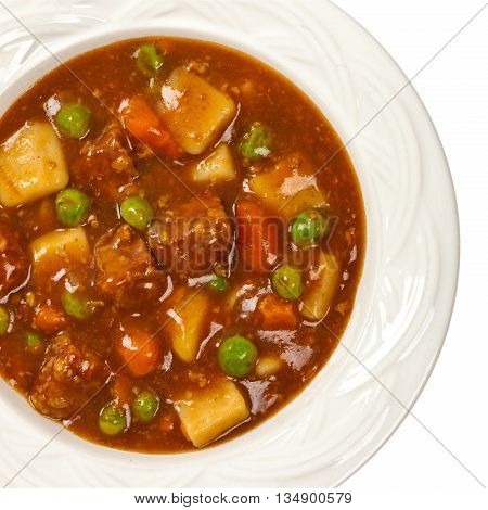 Homemade Slow Cooker Beef Stew Isolated on white. Selective focus.