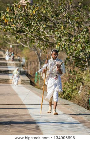 Palitana, India - March 6, 2016: Jain monks on parikrama, walking pilgrimage, to Jain temples on top of Shatrunjaya hill, Palitana (Bhavnagar district), Gujarat, India