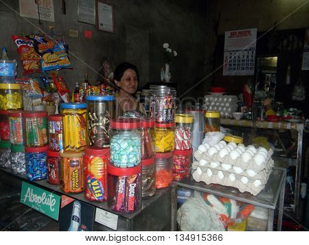 CEBU CITY, CEBU / PHILIPPINES - JULY 30, 2011: Fresh eggs, candies, and various other items are available for sale at a small store in Cebu City in the Philippines.