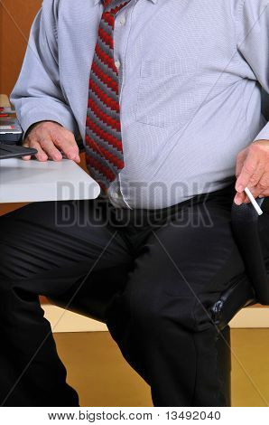 Middle age business man holding a cigarette