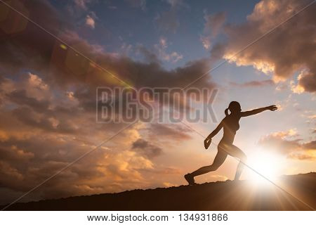 Profile view of sportswoman practising discus throw against clouds