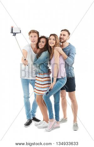 Young cheerful friends taking selfie isolated on white