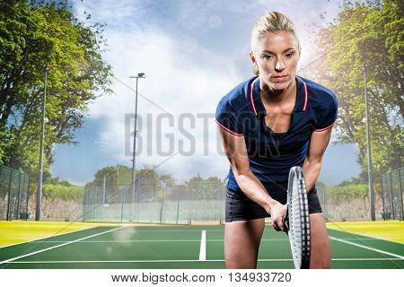 Tennis player playing tennis with a racket against composite image of tennis field on a sunny day