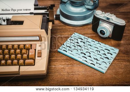 Meilleur papa pour toujours message against view of an old typewriter and camera