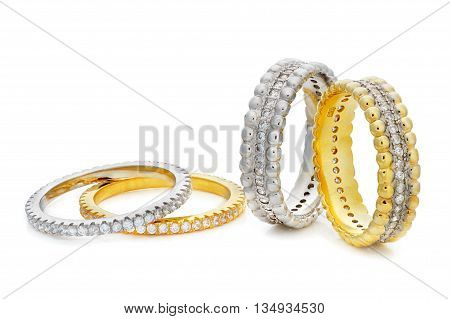 Close-up On Four Bracelets Made Of A Gold And A Silver With Diamonds