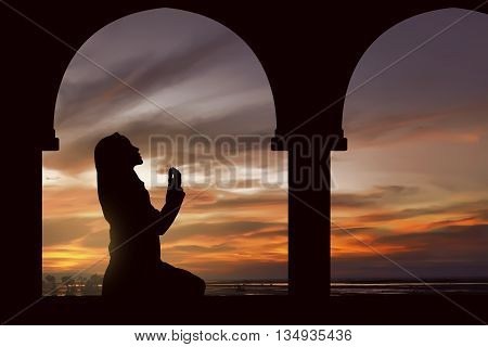 Silhouette Of A Women Praying During Sunset