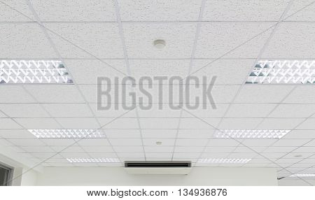 Ceiling and lighting inside office building, white color.