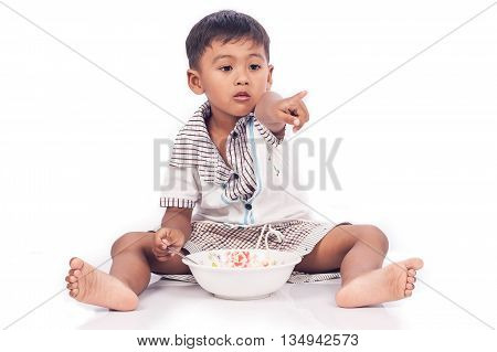 cute little boy eating food on white background