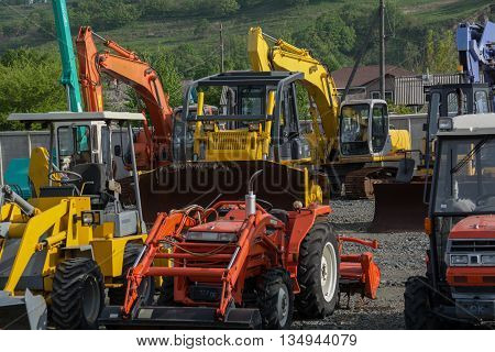 Bulldozers excavators and other construction equipment outdoor