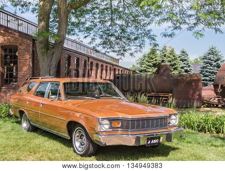DEARBORN MI/USA - JUNE 18 2016: A 1976 AMC Matador station wagon at The Henry Ford (THF) Motor Muster car show, held at Greenfield Village, near Detroit, Michigan.