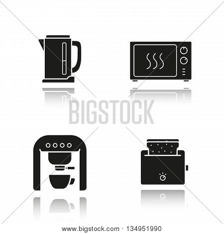 Kitchen appliances drop shadow black icons set. Electric kettle, microwave oven, coffee machine and toaster. Isolated vector illustrations