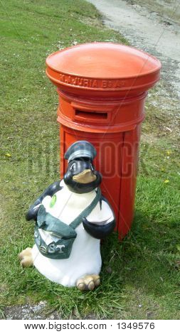 a model of a penguin in the guise of a post man ushuaia argentina poster