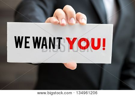 We want you message on blackboard and hold by businessman