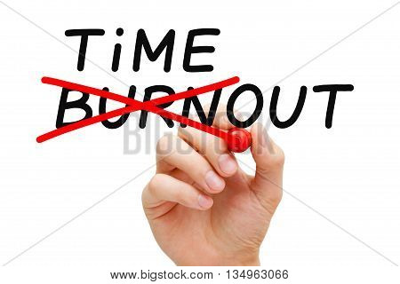 Hand writing Burnout Timeout concept with marker on transparent wipe board. To avoid falling victim to burnout you need to take a timeout.