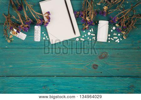 Workplace Of Doctor - Medicine Clipboard, Bottle, Flower And Pils