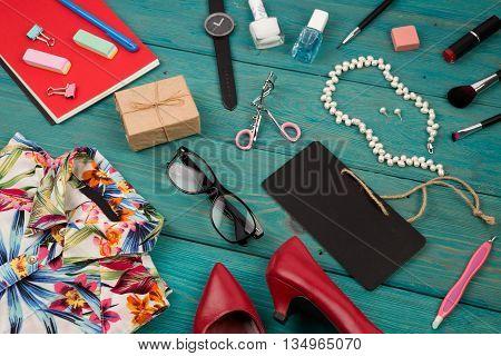 Sale Concept - Set Of Woman Stuff On Blue Wooden Background, Essentials, Accessories