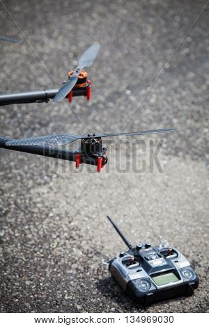 Close up shot of one of the propellers form an octocopter drone with a remote controller. poster