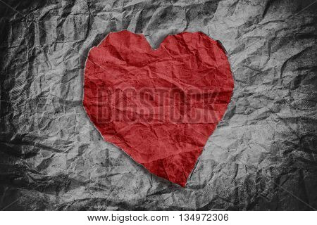 Red heart on crumpled paper texture, heart background, crumpled texture