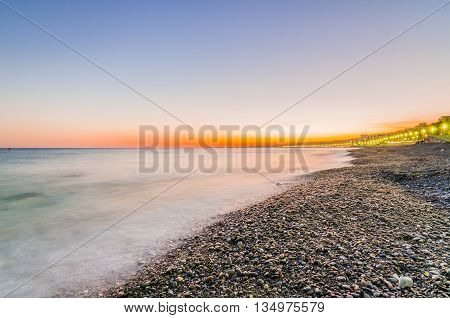 France, Nice, Cote d'Azur - Sunset on the beach of Promenade des Anglais