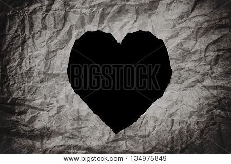 Heart shape, on crumpled paper texture background, abstract texture background
