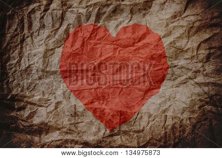 Red heart shape on old crumpled paper texture, heart background, crumpled texture
