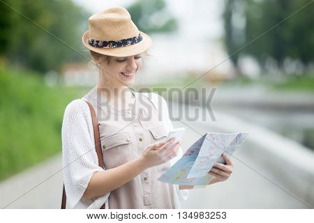 Young Traveler Woman Holding Map And Phone During Abroad Trip