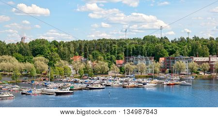 LAPPEENRANTA, FINLAND - JUNE 15, 2016:  Summer landscape with boats in Lappeenranta Harbor on Saimaa Lake. View from Linnoitus Fortress