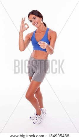 Smiling Brunette Woman Pointing And Gesturing