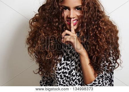 Woman With A Big Curly Hair Making Shhh!