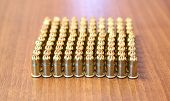 Many idle construction ammunition bullets on the table poster