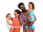 Happy interracial family is celebrating laughing and having fun with Hispanic African American Father Caucasian mother and Mulatto children daughters. Isolated on white. poster