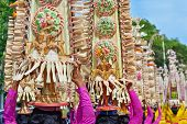 Beautiful Balinese women in traditional ethnic costumes - sarong carry offerings for Hindu ceremony. Arts festivals in Indonesia culture of Bali island and Indonesian people Asian travel background poster