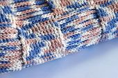 Closeup of folded edge of hand crocheted blanket in a basket weave design. poster