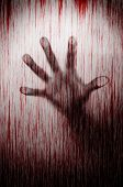 Blurry murderer hand behind matted glass with blood stain murder concept poster