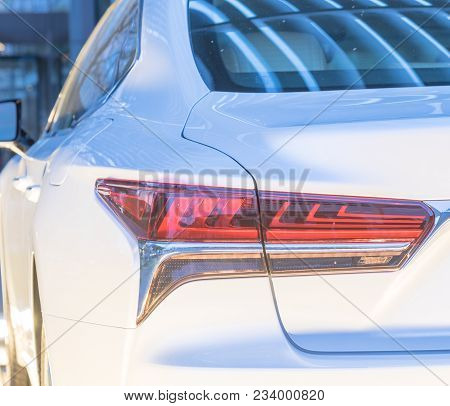 Close-up Of Rear Light Of Modern White Car