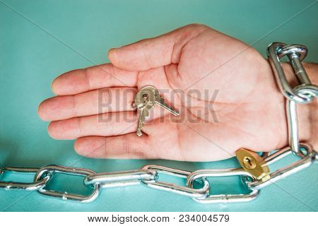 A Hand Chained In A Chain Holds The Keys As A Symbol Of Free Society And Human Rights.