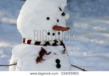 Close Up Head And Shoulders Image Of A Snowman In Winter