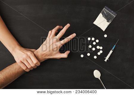 Drug Addict Hands On Dark Table