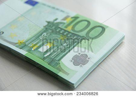 Paper Banknotes Euro, 100 Euro. A Bundle Of Paper Banknotes Of 100 Euros