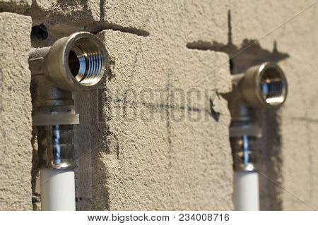 Water Pipes Made Of Polypropylene In The Wall, Plumbing In The House. Installation Of Sewer Pipes In