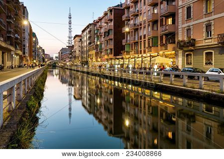 Naviglio Grande Canal In The Evening, Milan, Italy. Naviglio Grande Is One Of The Main Tourist Attra